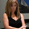 Jenny Holtzclaw listens to her brother, Daniel Holtzclaw, call from prison following a showing of the CRTV program, Michelle Malin Investigates, Saturday September 9, 2017 featuring the Holtzclaw case. (Billy Hefton / Enid News & Eagle)