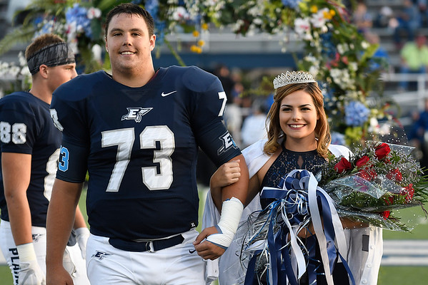 Enid High School homecoming queen, Elizabeth Musa, is escorted by homecoming king, Austin Whitehead, during ceremonies Friday September 29, 2017 at D. Bruce Selby Stadium. (Billy Hefton / Enid News & Eagle)