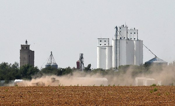 A tractor is engulfed in dust as it works a field near Carrier Friday September 8, 2017. (Billy Hefton / Enid News & Eagle)