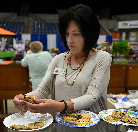 Brenda Medlock judges cookies at the Garfield County Fair Thursday September 7, 2017 at the Chisholm Trail Expo Center. (Billy Hefton / Enid News & Eagle)