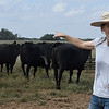 Annette Thomas gestures as she talks about the cattle at TLC Grassfed Beef Farm south of Meno Thursday September 13, 2018. (Billy Hefton / Enid News & Eagle)