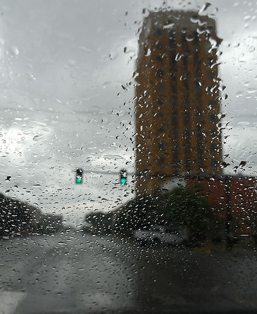 Broadway Tower seen through a raindrop covered windshield as a rain shower that moved through central Enid Monday afternoon. (Billy Hefton / Enid News & Eagle)