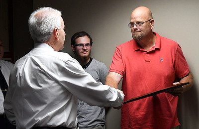 Enid Chief of Police Brian O'Rouke presents Matthew Winbolt with a Certificate of Merit Tuesday September 11, 2018 at the Enid Police Department. (Billy Hefton / Enid News & Eagle)