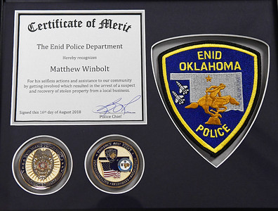 Enid Police Department presented Matthew Winbolt with a Certificate of Merit Tuesday September 11, 2018 at the Enid Police Department. (Billy Hefton / Enid News & Eagle)