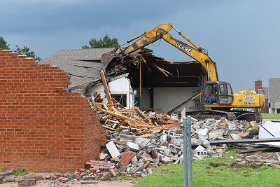 A tract hoe demolishes the old Fire Station #4 on west Garriott Wednesday September 5, 2018. (Billy Hefton / Enid News & Eagle)