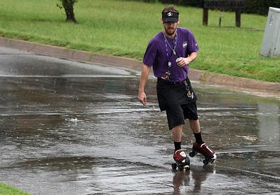 Joshua Delaney skates down 16th street through the rain on his way to work Tuesday September 4, 2018. (Billy Hefton / Enid News & Eagle)