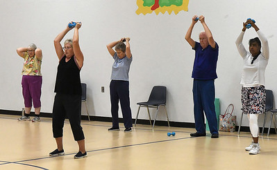People take part in the Integris fitness program, Fit Club, Tuesday September 11, 2018 at the Champion Park Gym. (Billy Hefton / Enid News & Eagle)