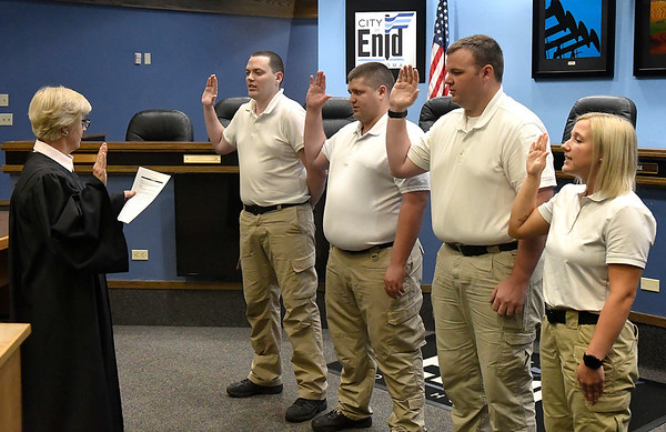 Enid Municipal Judge Linda Pickens swears in the newest Enid police officers, Zayne Herbel, Colten Herell, Brock England and Couirtney Cheatam  Thursday, September 5, 2019. (Billy Hefton / Enid News & Eagle)