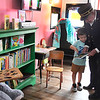 """Frank """"Watermelon"""" Campbell shows Miller Williams a book while inside the new """"Little Red Caboose Children's Library & Learning Center"""" at the Railroad Museum of Oklahoma Wednesday, September 23, 2020. (Billy Hefton / Enid News & Eagle)"""