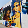 Tox Murillo works on a 1980's themed mural on north Independence Friday, September 18, 2020. Murillo uses a brush for detail work but, the majority of the mural is painted with spray cans. (Billy Hefton / Enid News & Eagle)