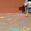 Janet Cordell draws messages of appreciation on the sidewalk in front of Great Salt Plains Health Tuesday, September 15, 2020. (Billy Hefton / Enid News & Eagle)