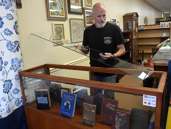 Jim Maughn assembles a book case at Old Soul Used and Antique Books Wednesday, September 8, 2021. (Billy Hefton / Enid News & Eagle)