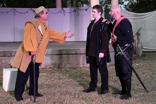 """(left to right) Brice Donalson, Jean-Renee White and Chris McDainiel rehearse a scene from the Gaslight Theater's Shakespeare in the Park production of """"The Tempest"""" Wednesday, September 8, 2021 at Government Spriings Park. (Billy Hefton / Enid News & Eagle)"""