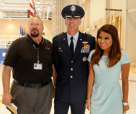 Col. Clark J. Quinn (center), new Commander of the 71st Flying Training Wing at Vance Air Force Base pauses for a photograph with J. Curtis Huckleberry (left), News Director at KGWA AM 960 and 103.1 KOFM and Broadcast Central's intern following the Change of Command ceremony Wednesday, June 18, 2014. (Staff Photo by BONNIE VCULEK)
