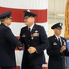 Gen. Robin Rand thanks Col. Darren V. James for his 24-month service as Commander of the 71st Flying Training Wing at Vance Air Force Base after awarding Col. James the Legion of Merit. (Staff Photo by BONNIE VCULEK)