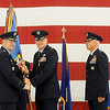 General Robin Rand (left) accepts the 71st Flying Training Wing colors from Col. Darren V. James during the change of command ceremony at Vance Air Force Base Wednesday, June 18, 2014. Col. Clark J. Quinn (right) assumed command during the ceremony after Col. James 24-month command in Enid. (Staff Photo by BONNIE VCULEK)