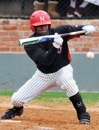 NOC's T.J. Turner lays down a sacrifice bunt Sunday at David Allen Memorial Ballpark during Jets 3-2 loss to Murray State. (Staff Photo by BILLY HEFTON)