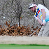 Landon Dixon chips onto the 6th green Sunday at Oakwood Country Club during the Dick Lambertz Memorial 4-Ball Tournament. (Staff Photo by BILLY HEFTON)