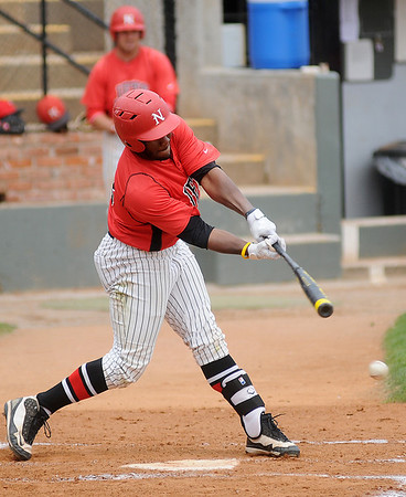NOC Enid Jets' Sammy Terry connects for a single against Carl Albert at David Allen Memorial Ballpark Thursday, April 25, 2013. (Staff Photo by BONNIE VCULEK)