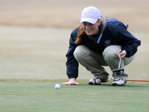 Enid's Katelynn Bennett aligns her put on No. 9 during the Enid Girls Golf Invitational at Meadowlake Golf Course Thursday, April 4, 2013. (Staff Photo by BONNIE VCULEK)