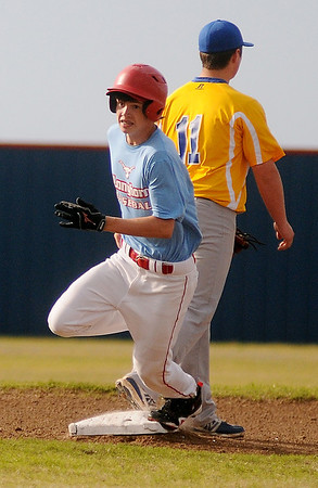 Chisholm's Trevor Galusha rounds second after hitting a triple during the district playoffs against Newkirk at Chisholm High School Thursday, April 25, 2013. (Staff Photo by BONNIE VCULEK)