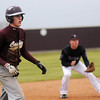 A Cashion runner takes a large lead off third during the OSSAA Class A Regional baseball tournament at Pioneer High School Friday, April 26, 2013. Cashion jumped out to an early 4-0 lead over the Mustangs. (Staff Photo by BONNIE VCULEK)