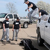 The Enid Yard Dogs leap from the back of a pickup as they prepare for the 4RKids Baseball Tournament at Crosslin Park Saturday, April 6, 2013. More than 25 teams participated in the two-day event that benefits the new Miracle League baseball field at the AMBUCS ABC Park in Enid. (Staff Photo by BONNIE VCULEK)