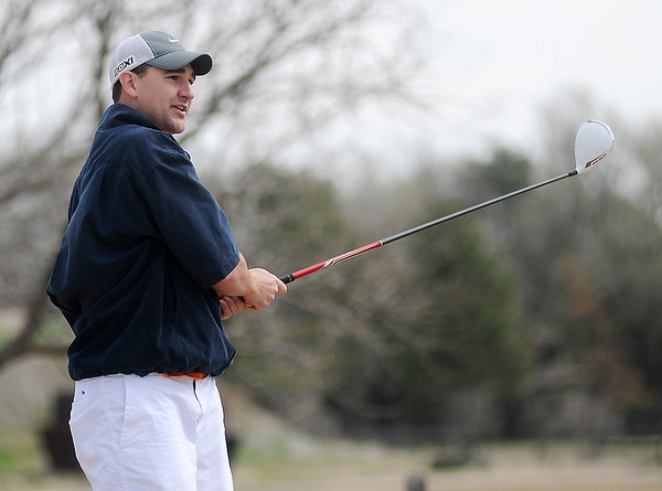 Kyle Tefft watches his tee shot sail along the No. 1 fairway during championship flight play at the Dick Lambertz Memorial Enid 4-ball Golf Tournament at Meadowlake Golf Course Saturday, April 6, 2013. (Staff Photo by BONNIE VCULEK)