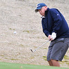 Josh Bugg chips onto the 8th green Sunday at Oakwood Country Club during the Dick Lambertz Memorial 4-Ball Tournament. (Staff Photo by BILLY HEFTON)