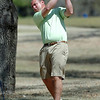 Heath Campbell hist his tee shot on the 14th hole Sunday at Oakwood Country Club during the Dick Lambertz Memorial 4-Ball Tournament. (Staff Photo by BILLY HEFTON)