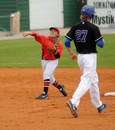 NOC Enid Jets' Dyce Applegate turns a double play during the Jets' 4-2 win over the Carl Albert Vikings at David Allen Memorial Ballpark Thursday, April 25, 2013. (Staff Photo by BONNIE VCULEK)