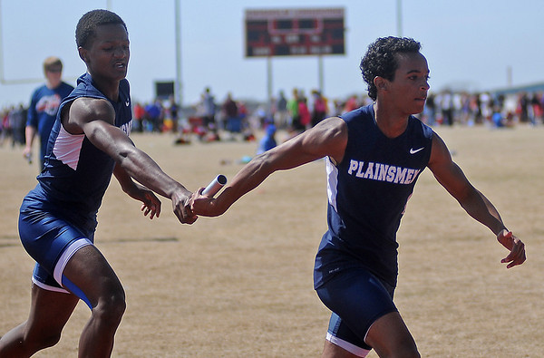 Enid Plainsmen complete a baton pass in the 400 relay during the Chisholm High School Boys and Girls Invitation Track and Field Meet Friday, April 12, 2013. (Staff Photo by BONNIE VCULEK)