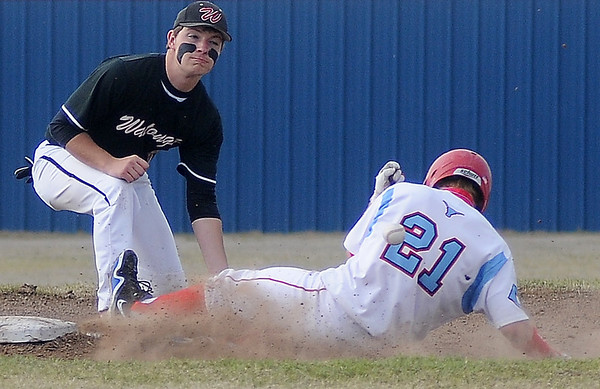 Chisholm's Brock Chance beats the throw to second during the Longhorns win against Watonga at Chisholm High School Friday, April 12, 2013. (Staff Photo by BONNIE VCULEK)