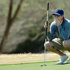 Heath Meyers contemplates his putt on the 14th green Sunday at Oakwood Country Club during the Dick Lambertz Memorial 4-Ball Tournament. (Staff Photo by BILLY HEFTON)