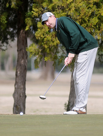 Kyle Tefft rolls a long putt toward the No. 2 cup during championship flight play at the Dick Lambertz Memorial Enid 4-ball Golf Tournament at Meadowlake Golf Course Saturday, April 13, 2013. (Staff Photo by BONNIE VCULEK)