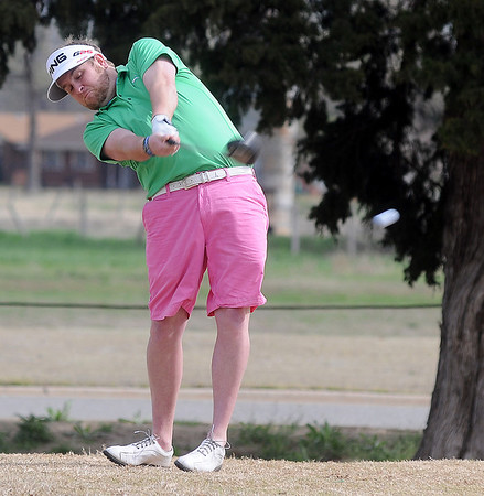 Landon Dixon hits his tee shot on the No. 1 fairway during championship flight play at the Dick Lambertz Memorial Enid 4-ball Golf Tournament at Meadowlake Golf Course Saturday, April 13, 2013. (Staff Photo by BONNIE VCULEK)