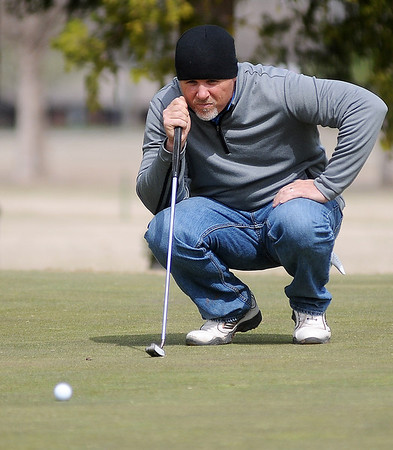 Jay Betchan lines up his putt on No. 2 during championship flight play in the Dick Lambertz Memorial Enid 4-ball golf tournament at Meadowlake Golf Course Saturday, April 13, 2013. (Staff Photo by BONNIE VCULEK)