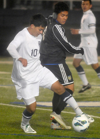 Enid's Oscar Pena gains control of the ball from a Stillwater defender Tuesday at D. Bruce Selby Stadium. (Staff Photo by BILLY HEFTON)