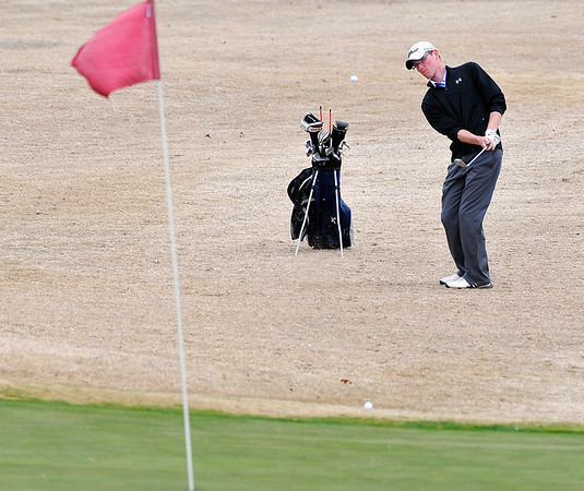 Colton Jackson chips on to the second green Monday at Oakwood Country Club during the Enid Invitational. (Staff Photo by BILLY HEFTON)