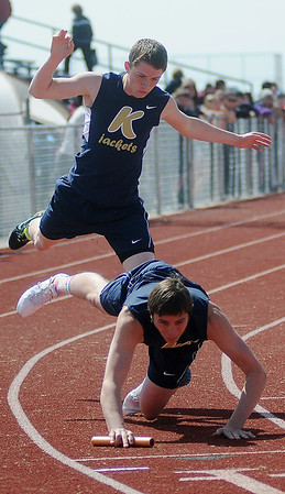 Kingfisher runners collide as they exchange the relay baton during the Chisholm High School Boys ad Girls Invitational Track and Field Meet Friday, April 12, 2013. (Staff Photo by BONNIE VCULEK)