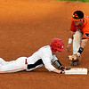 NOC-Enid's Haden Johnson dives back into second ahead of a tag from Connors State's Dalton Daniels Monday at David Allen Memorial Ballpark. (Staff Photo by BILLY HEFTON)