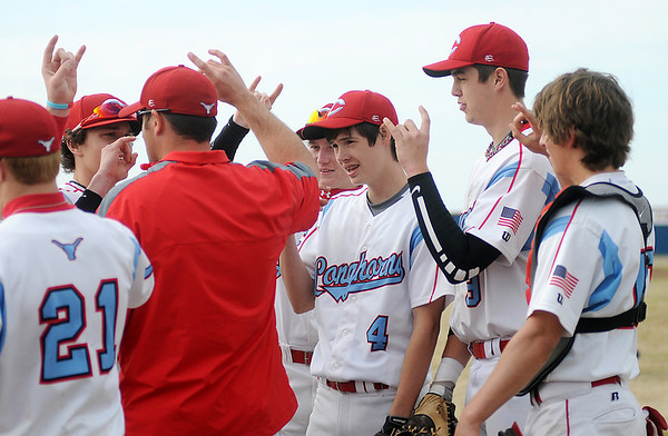 The Chisholm Longhorns celebrate their 11-0 lead over the Watonga Eagles between innings at Longhorn Field Friday, April 12, 2013. (Staff Photo by BONNIE VCULEK)