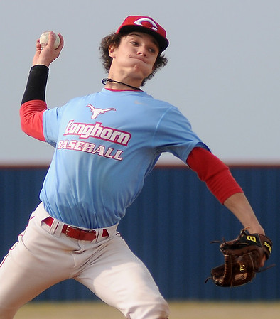 Chisholm's Tabor Charles strikes out several batters during the Longhorn's first district playoff game against Newkirk at Chisholm High School Thursday, April 25, 2013. (Staff Photo by BONNIE VCULEK)