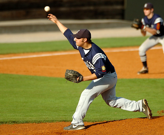 Enid's Zeke Sarver delivers a pitch against Mustang Monday at David Allen Memorial Ballpark. (Staff Photo by BILLY HEFTON)