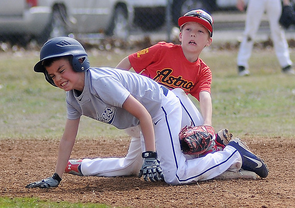 An Enid Astros' player attempts a tag on a Kingfisher Yellowjacket during the 4RKids Miracle League Baseball Tournament at Crosslin Park Saturday, April 6, 2013. (Staff Photo by BONNIE VCULEK)
