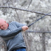 Jay Betchan hits a tee shot Sunday at Oakwood Country Club during the Dick Lambertz Memorial 4-Ball Tournament. (Staff Photo by BILLY HEFTON)
