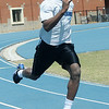 Alex Lofton, a sprinter for the Enid High School Plainsmen track team, practices for a district meet Friday, April 19, 2013. (Staff Photo by BONNIE VCULEK)