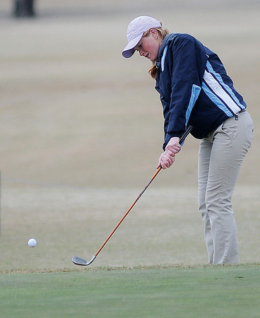 Enid's Katelynn Bennett chips onto the No. 9 green during the Enid Girls Golf Invitational at Meadowlake Golf Course Thursday, April 4, 2013. (Staff Photo by BONNIE VCULEK)