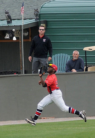 NOC Enid Jets' Sammy Terry snags a foul ball near the left field warning track against Carl Albert Thursday, April 25, 2013. (Staff Photo by BONNIE VCULEK)