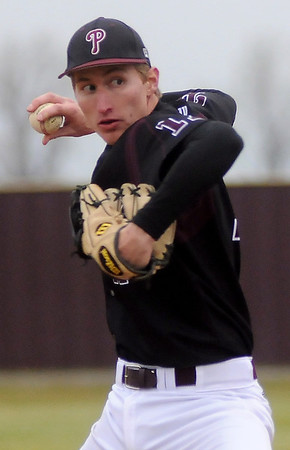 Pioneer's Blake Gabriel, 17, delivers a pitch to a Cashion batter during the OSSAA Class A Regional at Pioneer High School Friday, April 26, 2013. (Staff Photo by BONNIE VCULEK)